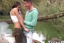 Big breasted teenie fucks with two studs in the forest